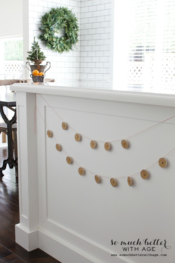 Christmas garland and wreath in white kitchen | somuchbetterwithage.com