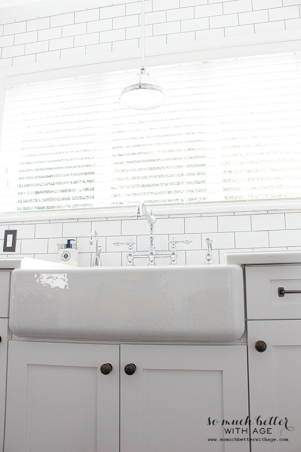 Bridge faucet / Industrial Vintage French kitchen | somuchbetterwithage.com