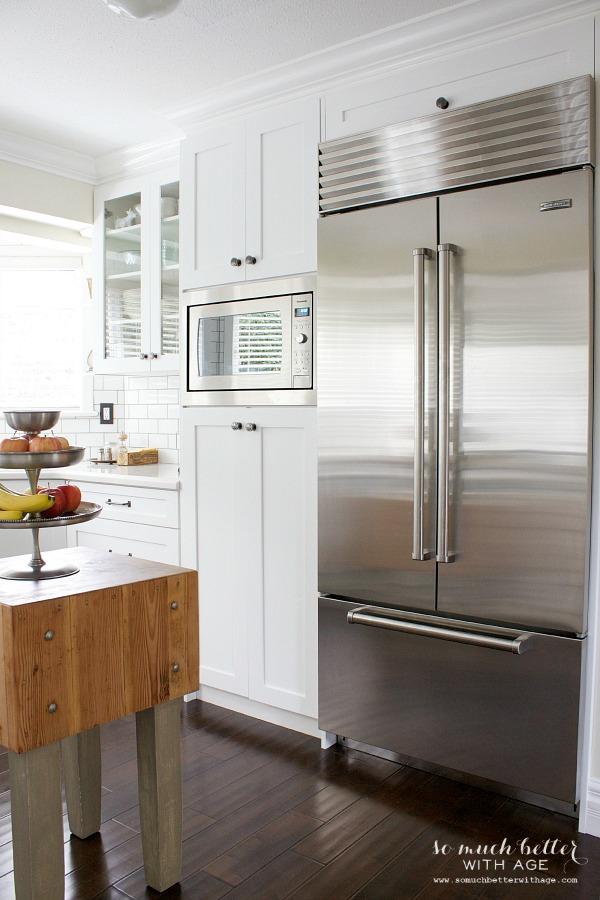 Sub zero fridge / Industrial Vintage French kitchen | somuchbetterwithage.com