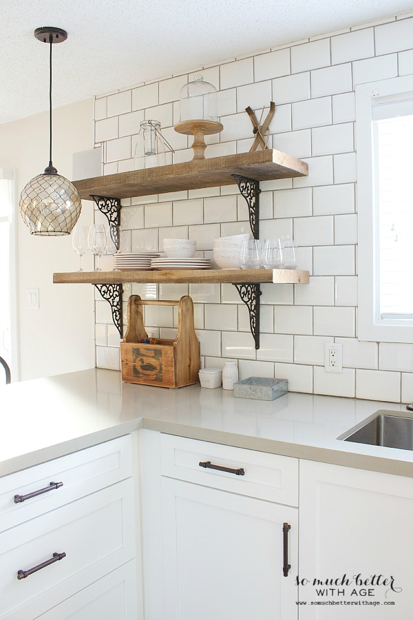 White subway tile and rustic shelves by somuchbetterwithage.com