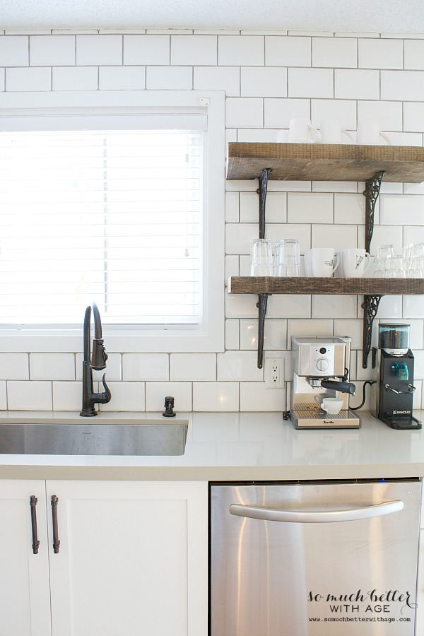 White subway tile and open rustic wooden shelves by somuchbetterwithage.com