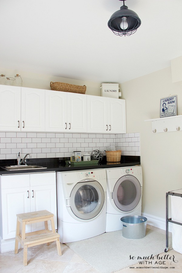 Updated white industrial laundry room | somuchbetterwithage.com