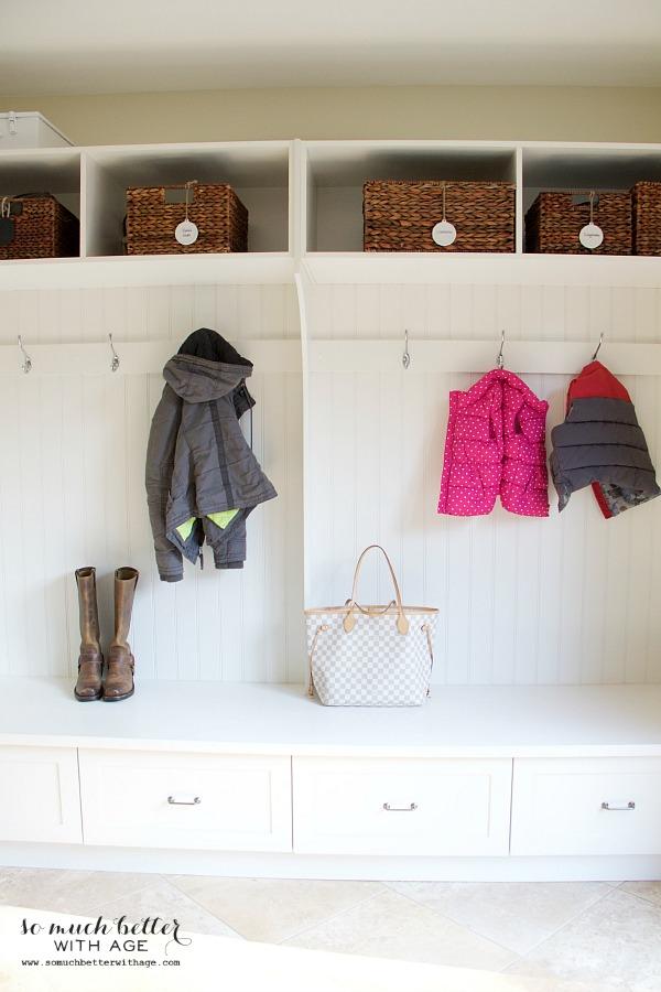 Coat racks in laundry room | somuchbetterwithage.com