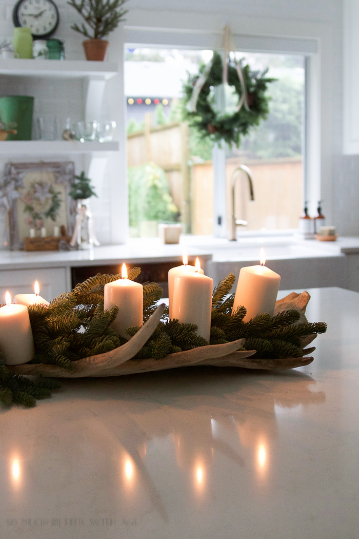 Noble fir and candles in moose antlers - Christmas kitchen tour 2016