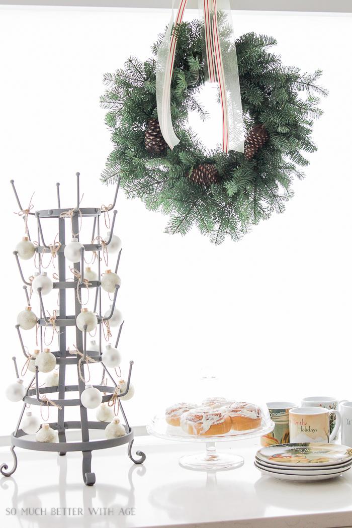 Green wreath over window, drying rack decorated- Christmas kitchen tour 2016