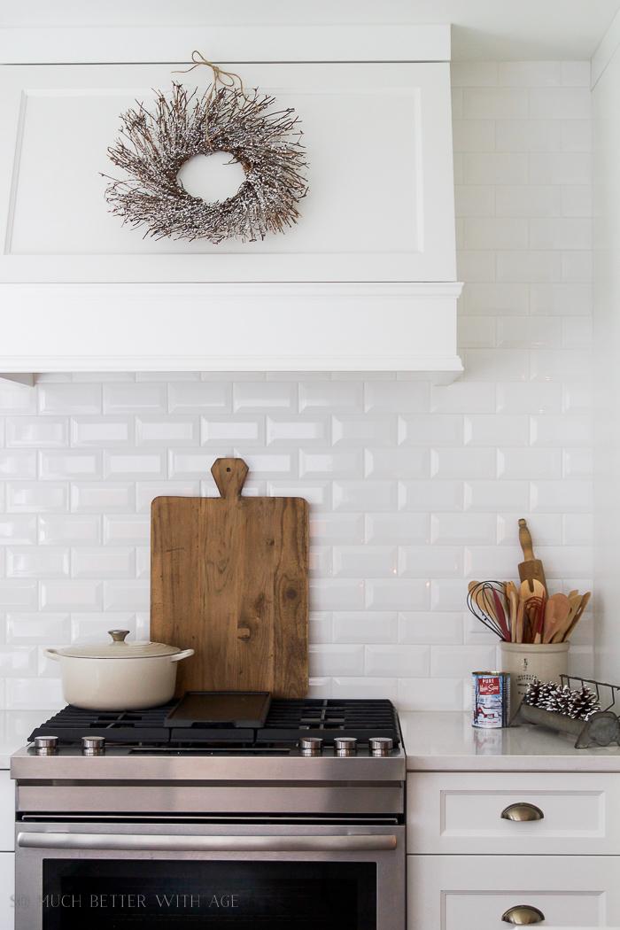 White kitchen, wreath on range hood- Christmas Kitchen Tour 2016