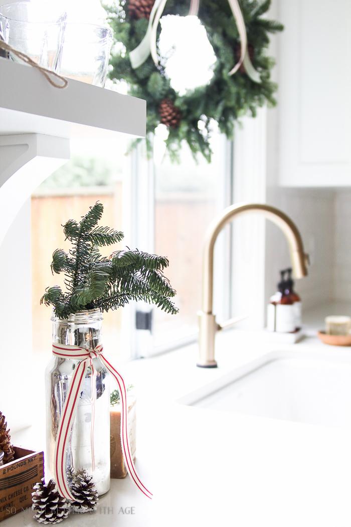 Green wreaths in kitchen - Christmas kitchen tour 2016