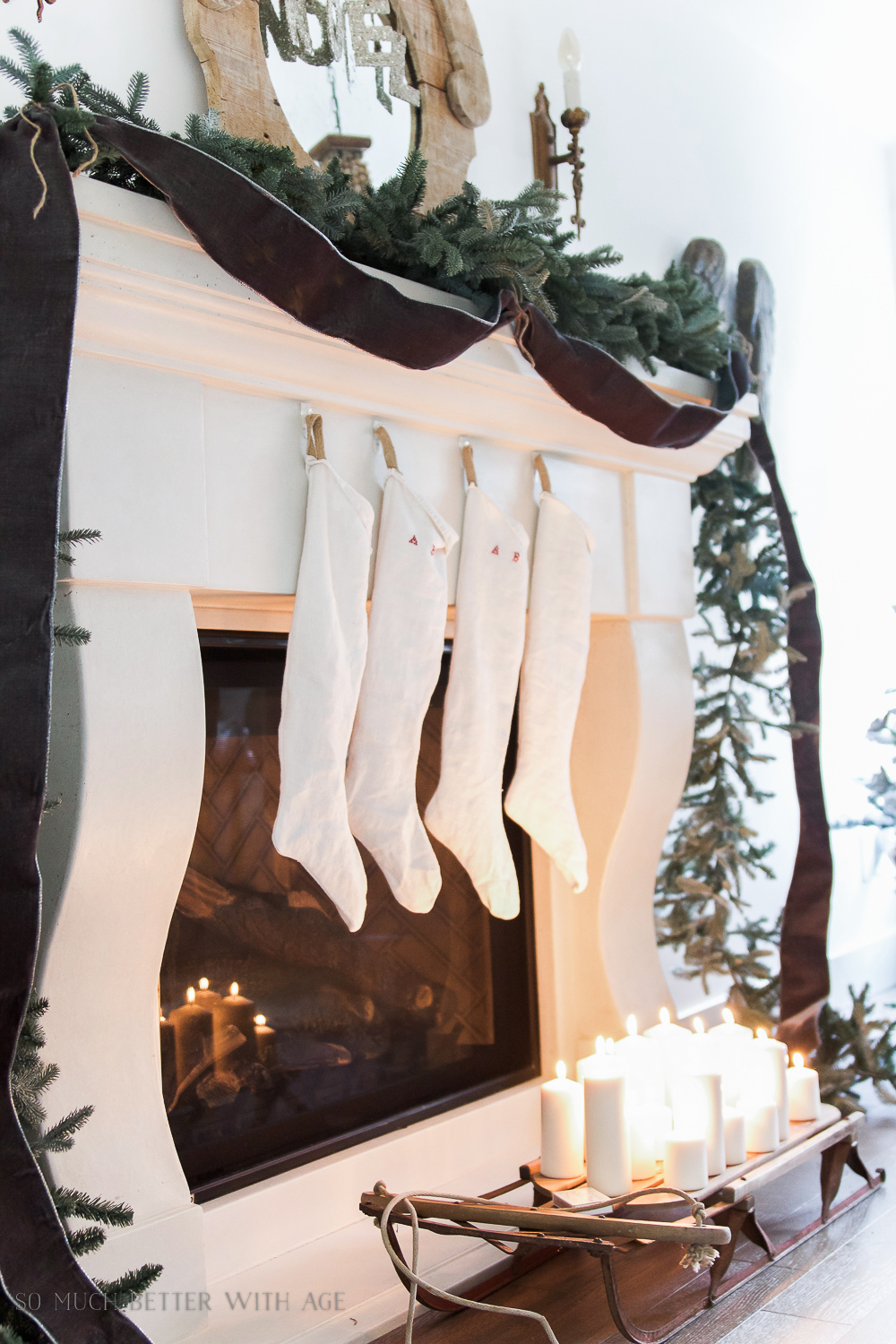 Christmas garland, velvet ribbon, sled and candles - Christmas Mantel 2016