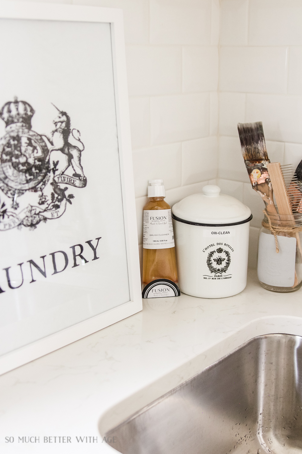 White mudroom/laundry room with vintage brushes - Tiny Vintage Mudroom Makeover